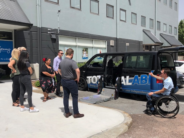 Man shows Blue Badge Insurance team vehicle option for people with disability