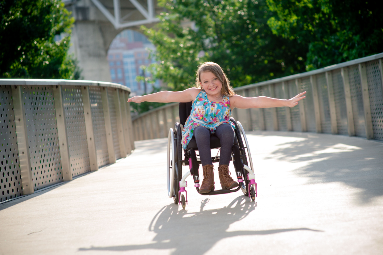 Girl is happy to have chosen one of the suitable children's wheelchairs