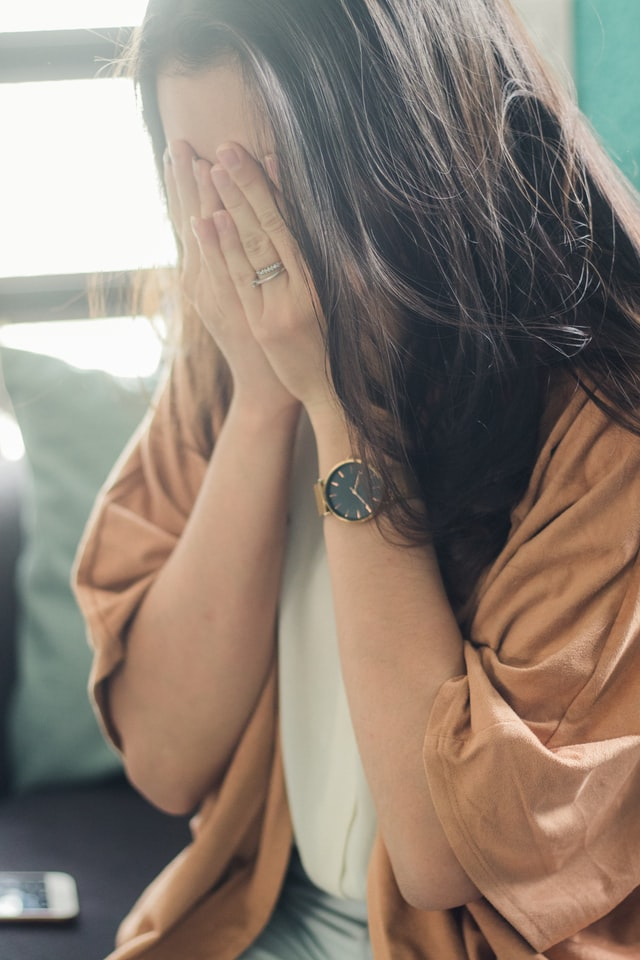 a dark haired woman crying because she is struggling to cope with chronic pain