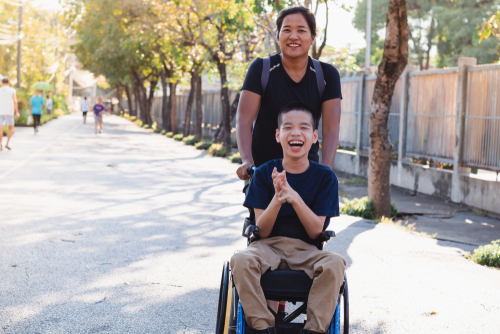 tween boy in wheelchair with his disability support worker