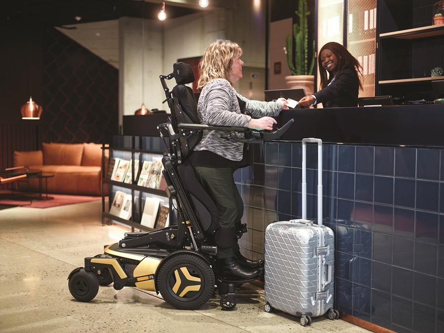 this woman at a hotel desk had insurance for your wheelchair