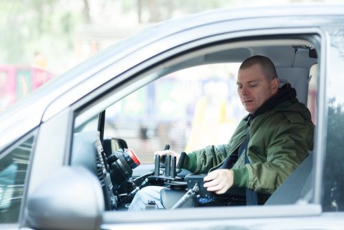 man takes disability converted vehicle for maintenance check