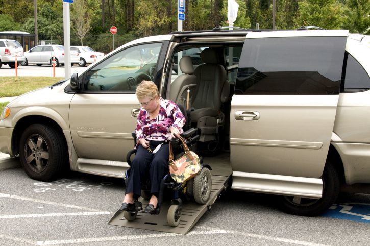 women in wheelchair exits disability converted vehicle