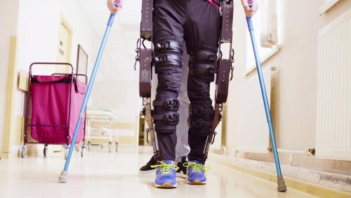 The exoskeleton suit helps paraplegics to walk